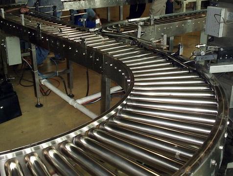 结构形式多样,滚筒式输送机按驱动方式可分为动力